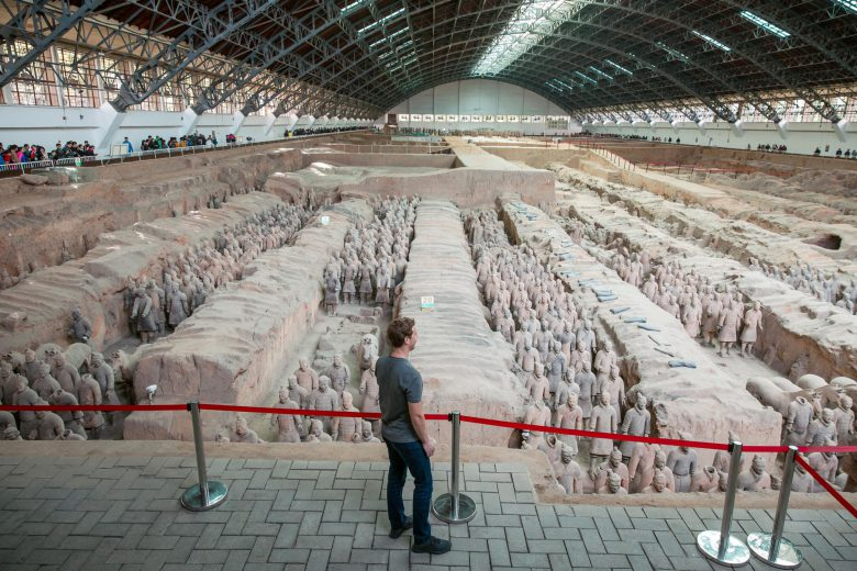 Mark Zuckerberg looking at the Terracotta Army in China.
