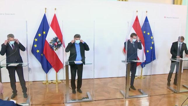 Regierungsvertreter mit Mund-Nasen-Schutz. © BKA / Screenshot